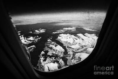 Looking Out Of Aircraft Window Over Snow Covered Fjords And Coastline Of Norway  Art Print by Joe Fox
