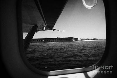 Looking Out Of Seaplane Window Coming In To Land On The Water In A Seaplane Next To Fort Jefferson G Art Print by Joe Fox