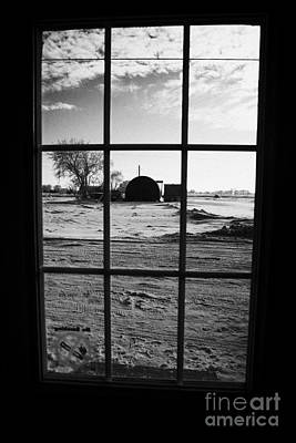 looking out through door window to snow covered scene in small rural village of Forget Art Print by Joe Fox
