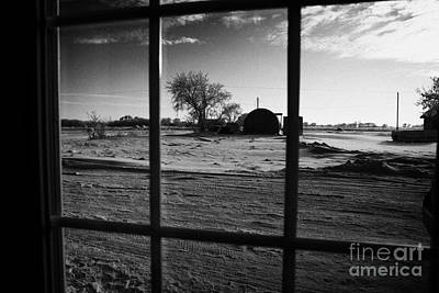 looking out through door window to snow covered scene in small rural village of Forget Saskatchewan  Art Print by Joe Fox