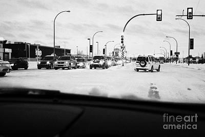 looking through car windshield at snow covered city intersection Saskatoon Saskatchewan Canada Art Print by Joe Fox