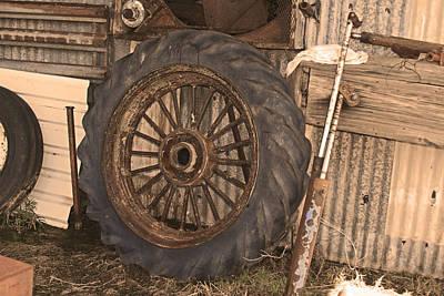 Photograph - Louisiana Sugar Cane Tractor Wheel by Ronald Olivier