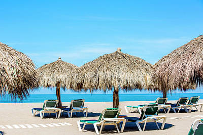 Lounge Chair Photograph - Lounge Chairs And Thatch Umbrellas On by Inti St Clair