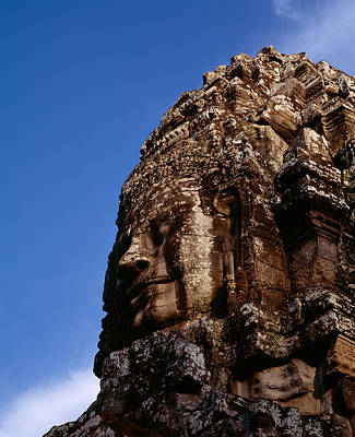 Angkor Thom Photograph - Low Angle View Of A Face Carving by Panoramic Images