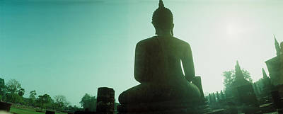 Low Angle View Of A Statue Of Buddha Art Print