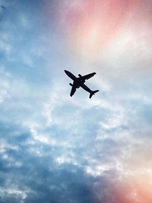 Low Angle View Of Airplane Flying In Art Print by Maurice Rivera / Eyeem