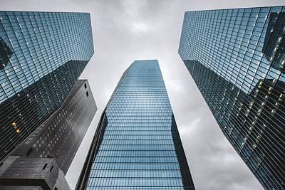 Low Angle View Of Modern Buildings Art Print by Oliver Byunggyu Woo / Eyeem