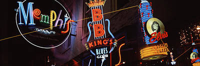 Low Angle View Of Neon Signs Lit Art Print by Panoramic Images