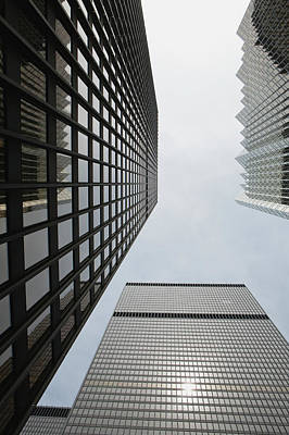 Photograph - Low Angle View Of Skyscrapers Towering by Michael Interisano / Design Pics