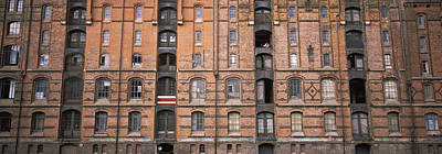 Repetition Photograph - Low Angle View Of Warehouses In A City by Panoramic Images