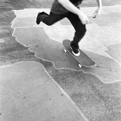 Photograph - Low Section Of A Skateboarder by Brian Caissie
