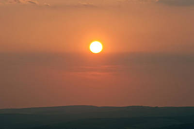 Low Setting Sun Over Distant Landscape Art Print by Matthew Gibson