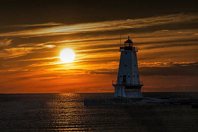 Photograph - Ludington Pier Lighthead At Sunset by Randall Nyhof