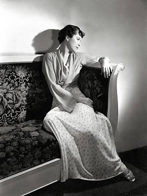 Madeleine Photograph - Madeleine De Bonnardel Sitting On A Couch by Horst P. Horst