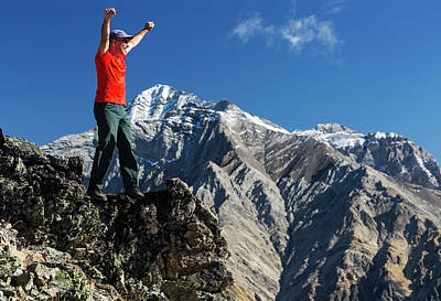 Male Hiker Standing With Arms Raised Art Print