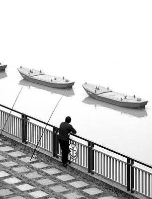Photograph - Man And Boats by Valentino Visentini