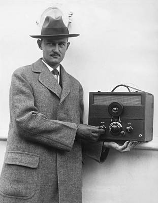 Electronics Photograph - Man And His Tiny Radio by Underwood Archives