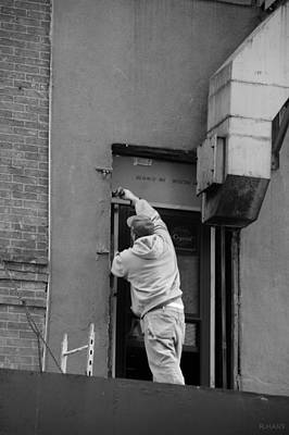 Photograph - Man At Work In Black And White by Rob Hans