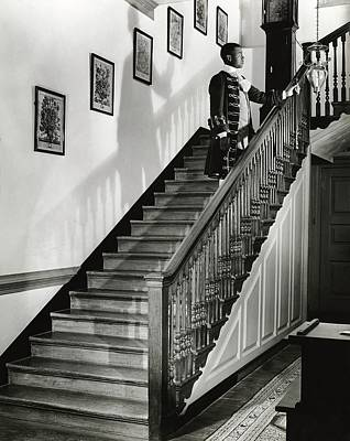 Antique Photograph - Man Dressed As Colonial Butler On The Stair by George Karger