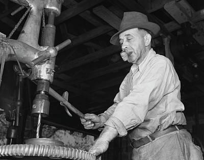 Man Drilling A Gear For The De Land Art Print