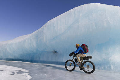 Man Fat Tire Mountain Biking On Ice At Art Print by Joe Stock