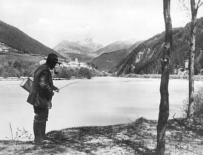 Man Fishing In Switzerland Art Print by Underwood Archives