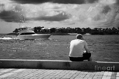 Man Fishing On Mallory Square Seafront Key West Florida Usa Art Print by Joe Fox
