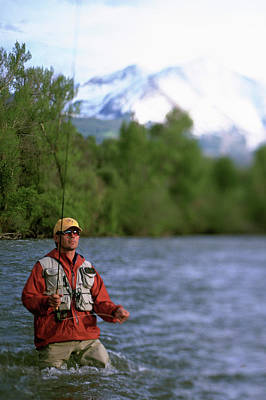 Colorado Fly Fishing River Wall Art - Photograph - Man Fly Fishing In Stream, Colorado by David Clifford