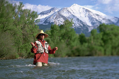 Colorado Fly Fishing River Wall Art - Photograph - Man Fly Fishing In The River by David Clifford