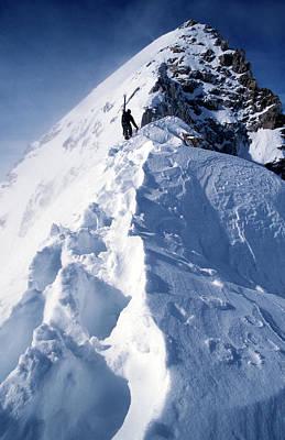 Man Hiking Up Ridgeline Of A Snowy Art Print