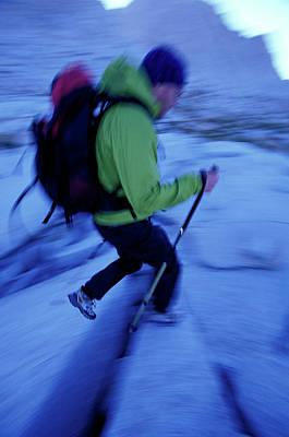 Rain Gear Photograph - Man Hiking With Trekking Poles by Corey Rich