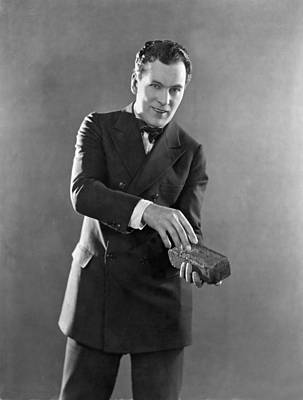 Actor Photograph - Man Holding A Brick by Underwood Archives
