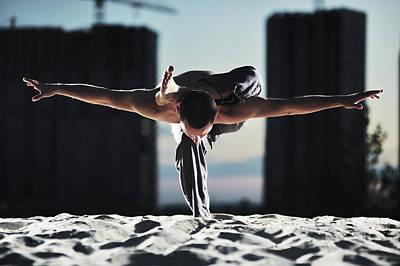Sunset Photograph - Man Holding Yoga Pose In The Sand by Myshkovsky