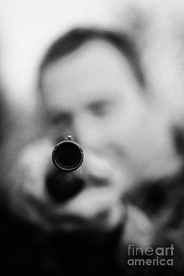 Man In Camouflage Clothes Takes Aim At Camera With Shotgun Close Up  On December Shooting Day Art Print
