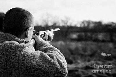 Man In Fleece Jacket Firing Shotgun Into Field With Cartridge Ejecting On December Shooting Day Art Print