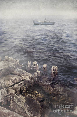 Photograph - Man In Row Boat On Foggy Sea by Jill Battaglia