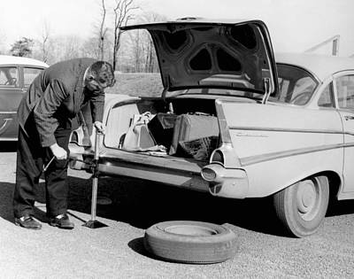 Excellence Photograph - Man Jacking Up A Car by Underwood Archives