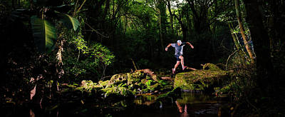 Leaves On Rock Photograph - Man Jumping Across A River, Kloof by Panoramic Images