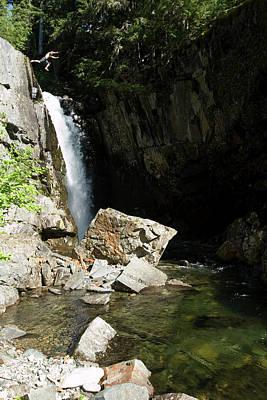 Charred Wall Art - Photograph - Man Jumping Off Waterfall In Idaho by Patrick Orton