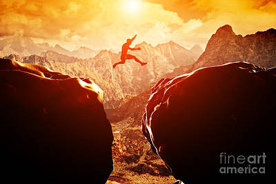 Man Jumping Over Precipice In Mountains Art Print by Michal Bednarek