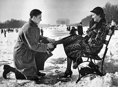 Lincoln Memorial Photograph - Man Lends A Helping Hand To Put On Skates by Underwood Archives