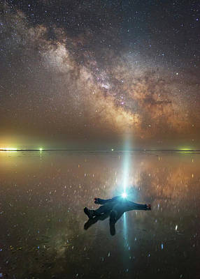 Target Threshold Nature - Man Lying On Lake Elton  In Russia by Yuri Zvezdny