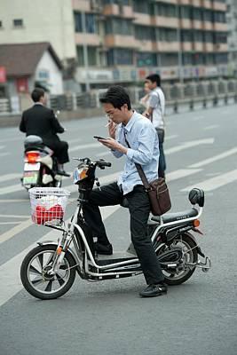 Man On A Battery-powered Moped Smoking Art Print by Tony Camacho