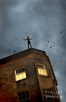 Photograph - Man On Top Of A Building At Night by Jill Battaglia
