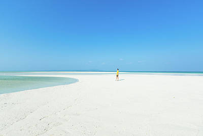 Photograph - Man On White Sandy Tropical Beach On by Ippei Naoi