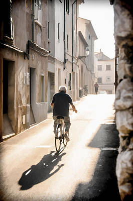 Man Riding Bicycle In Street In Puerto Pollenca Art Print