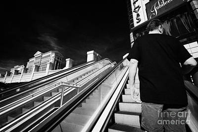man riding on escalators on Las Vegas boulevard Nevada USA Art Print by Joe Fox