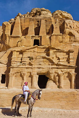 Jordan Photograph - Man Riding On Horse With The Tomb by Keren Su