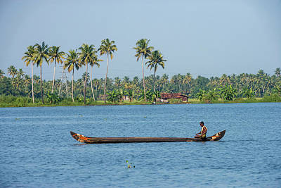 Canoe Photograph - Man Rowing A Long Wooden Canoe by Ali Kabas