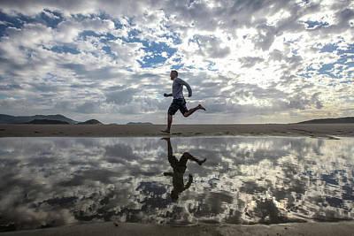 Man Running On Beach Art Print by Paul Mansfield Photography